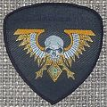 Grindcrusher Tour Woven Vintage Shield Patch by Games Workshop
