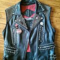 older personal leather vest