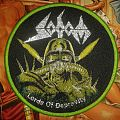 Round Sodom woven patch.