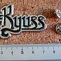 Kyuss shaped pin badge