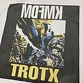 KMFDM xtort misprint