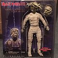 Iron Maiden Eddie Mummy clothed figure with two heads.