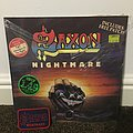 "Saxon nightmare 12"" single. Original- in wrapper condition with patch."