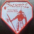 Sacrifice - Patch - Sacrifice street fighter innocent victim red border patch
