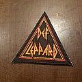 Def Leppard - Patch - Triangular Def Leppard patch.