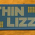 THIN LIZZY name and stars vintage woven patch (blue background)