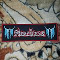Red bordered Merciless - The Awakening woven strip patch.
