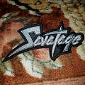 Embroidered shaped Savatage logo patch.
