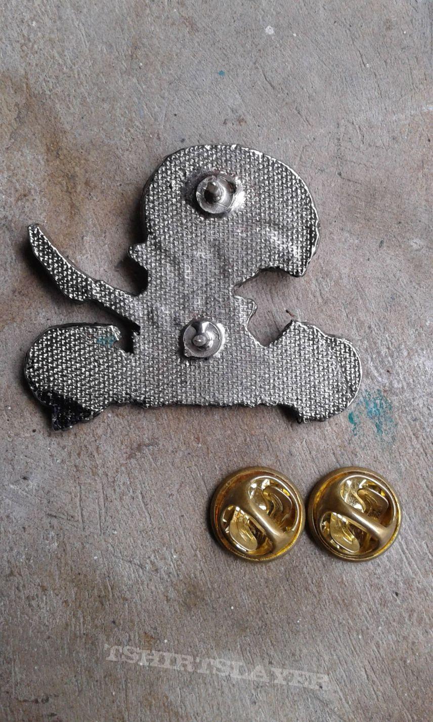 Entombed metal pin