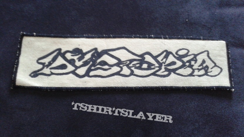 Dystopia logo patch, screen printed with embroidered edges.