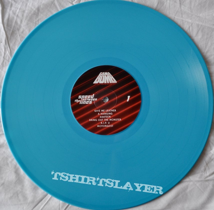 Gama Bomb – Speed Between The Lines Turquoise Vinyl